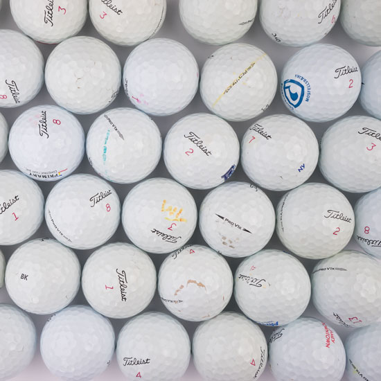 Here is an un-retouched picture of examples of near-mint Pro V1x's you may receive. Notice that while used, there is nothing that affects the integrity of the ball.